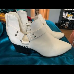 White buckled booties